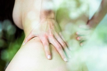 woman hands on lower back